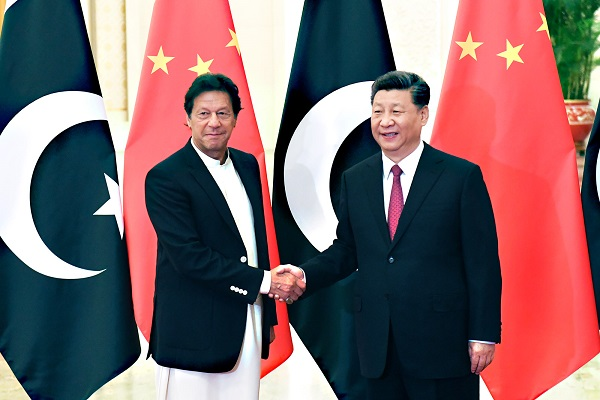 BEIJING, CHINA - APRIL 28: China's President Xi Jinping, right, shakes hands with Pakistan's Prime Minister Imran Khan before a meeting at the Great Hall of the People on April 28, 2019 in Beijing, China. (Photo by Madoka Ikegami-Pool/Getty Images)